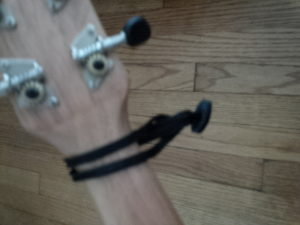 NeoTech Acoustic Guitar Strap Adapter on a Caramel CT 102A Zebrawood Tenor Ukulele